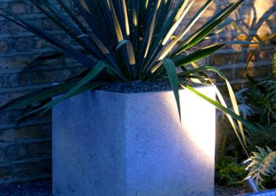 Scenic-lighting-wall-wash-through-planter